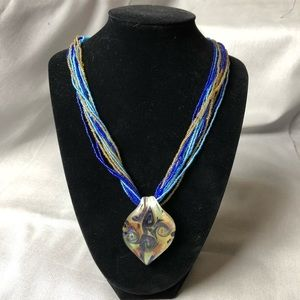 Multi strand glass pendant necklace